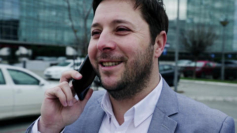 Businessman Talking on the Smartphone Outdoors in front of Office Building. Corporate Business GIF