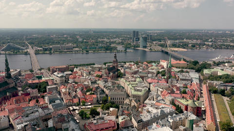 RIGA, LATVIA - MAY, 2019: Aerial view of the famous cathedrales and roofs in old Live Action