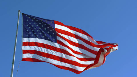 USA American Flag with a blue sky background Live Action