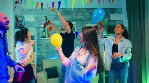 Attractive young woman partying with her friends Live Action
