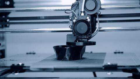 3D printer working. Fused deposition modeling, FDM. 3D printer Live Action