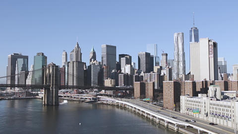 Manhattan Waterfront and Brooklyn Bridge on a Sunny Day Live Action