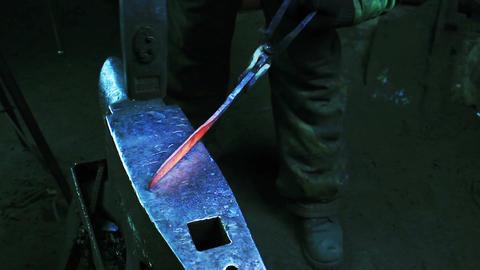 Blacksmith Forging a Knife Footage