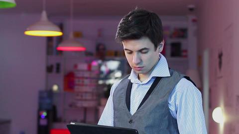 Man reading tablet pc, standing businessman HoReCa business Footage
