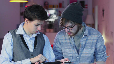 Two man socializing in cafe using gadgets in cafe restaurant Live Action