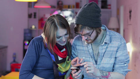 Man woman watching photos in mobile phone, smiling laughing Footage