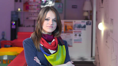 Smiling attractive woman in cafe restaurant looking into camera Footage