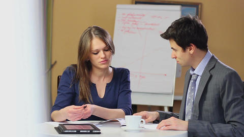 Business meeting, man and woman briefing reading charts solution Footage