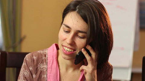 Close-up smiling woman talking over mobile phone, flirt chat Footage