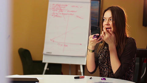 Business woman make up drawing lips eyes, lipstick in office Footage