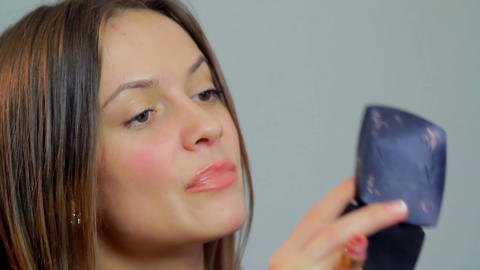 Smiling beautiful woman painting red lips lipstick makeup office Footage
