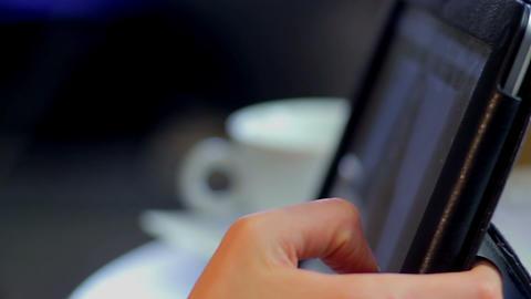 Woman watching internet video, fingers scroll, drinks coffee cup Footage