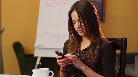 Business woman checks updates news in mobile touch phone, office Footage