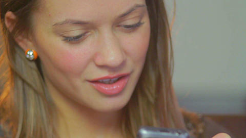 Attractive sexy young adult lady sending mobile phone message Footage