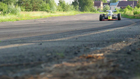 Formula 1 race cars rushing in hot pursuit for victory Live Action