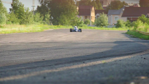 F1 competitors driving extremely fast, hot pursuit to win race Live Action