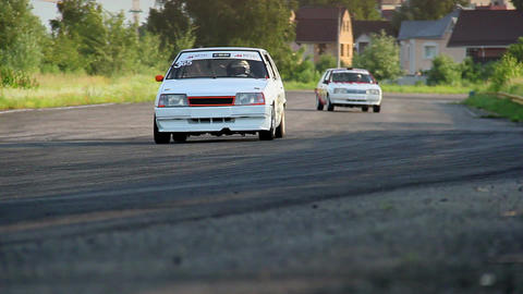 Autos racing on extremely high speed during summer tournament Footage
