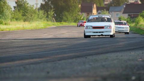 Pursuit of racing cars on asphalt road, fight for leadership Footage