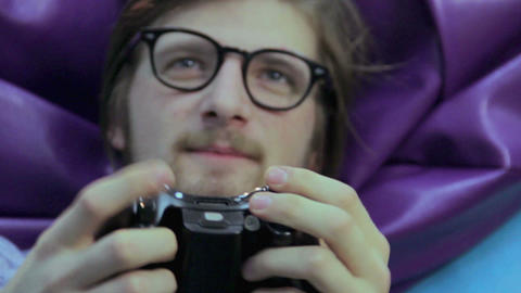 Man pushes joystick buttons, gaming addiction, time wasting Footage
