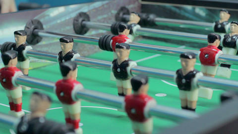 Close-up view table soccer figures, team-building, having fun Footage