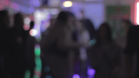 Rack focus people dancing in nightclub, enjoying nightlife Footage