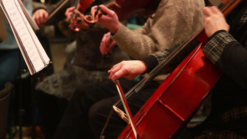 Cello musical instrument, female hand plays classical music Footage