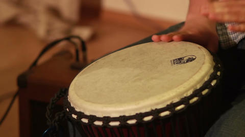 Male hands play drums, music speaker on background, classics Footage
