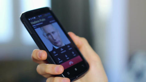 US government official receiving call from Putin, talks close-up Live Action