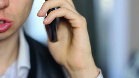 Man having serious phone conversation, half face close-up Footage