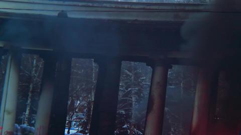 Black smoke rising above burnt building pillars, burning house Footage