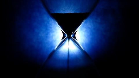 Hourglass time flow on blue background, time pass concept 4k Live Action