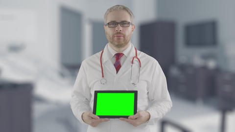 Concerned doctor holds modern tablet PC with green screen, shot on Red camera ライブ動画