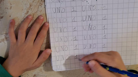 Little child hands writing, top view while doing school homework,education Live Action