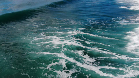 Splashing waves motion,aerial view over deep blue sea water,natural phenomenon Live Action