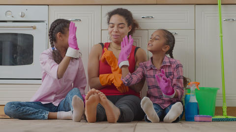 Cheerful family giving high five after cleanup Live Action