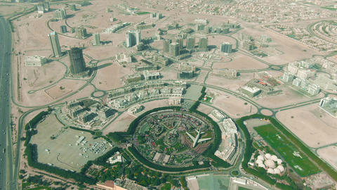 Aerial shot of the Dubai Miracle Garden within cityscape, UAE Live Action