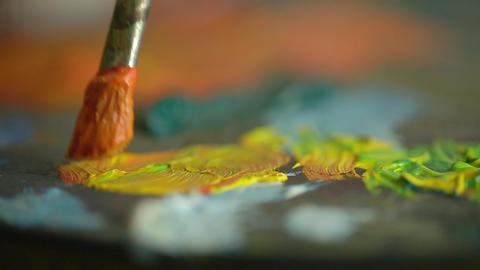 Close-up of brush with paint artist canvas ライブ動画