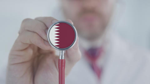 Doctor listening with the stethoscope with flag of Qatar. Qatari healthcare Live Action