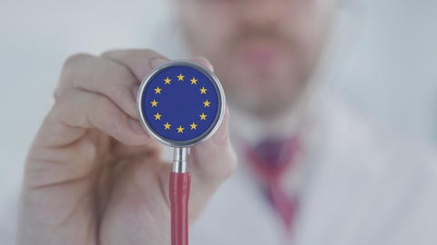 Doctor listening with the stethoscope with flag of the EU. European healthcare Live Action