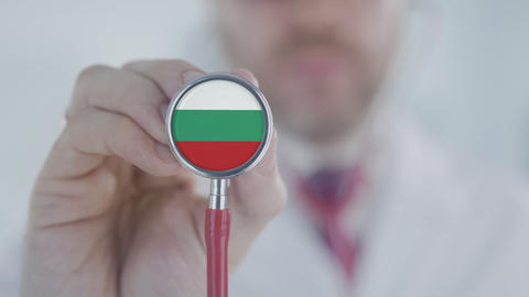 Doctor uses stethoscope with the Bulgarian flag. Healthcare in Bulgaria Live Action