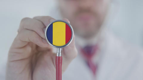 Doctor uses stethoscope with the Romanian flag. Healthcare in Romania Live Action