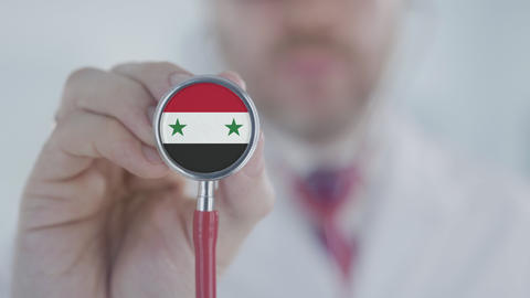 Doctor uses stethoscope with the Syrian flag. Healthcare in Syria Live Action