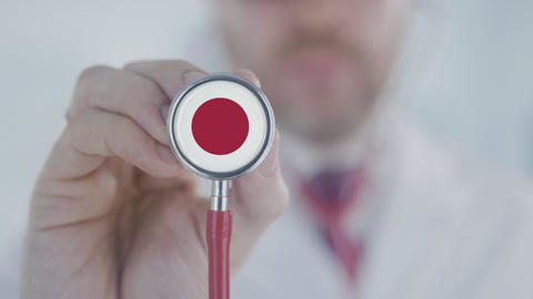 Doctor listening with the stethoscope with flag of Japan. Japanese healthcare Live Action