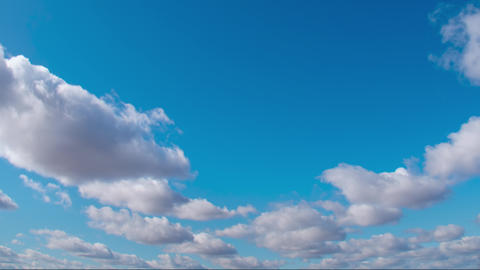 Cirrus clouds in a clear blue sky. White clouds move across the sky in spring Live Action