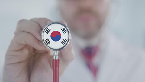 Doctor uses stethoscope with the South Korean flag. Healthcare in South Korea Live Action