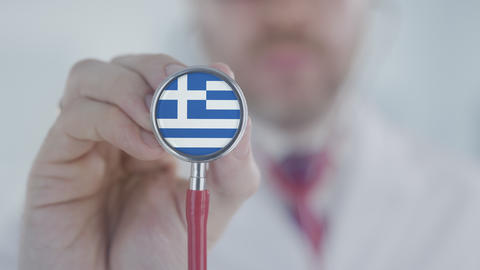 Physician uses stethoscope with the Greek flag. Healthcare in Greece Live Action