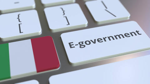 E-government or Electronic Government text and flag of Italy on the keyboard Live Action