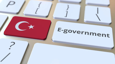 E-government or Electronic Government text and flag of Turkey on the keyboard Live Action