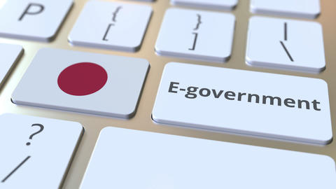 E-government or Electronic Government text and flag of Japan on the keyboard Live Action