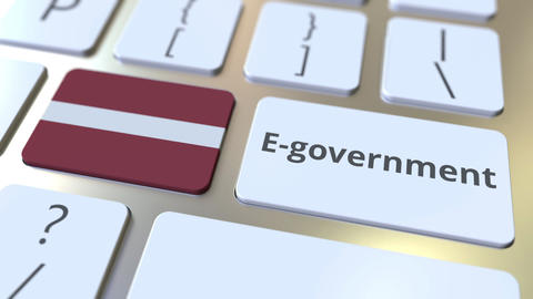 E-government or Electronic Government text and flag of Latvia on the keyboard Live Action